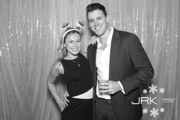 A photo booth photo of a good looking young couple at the JRK Holidays Holiday party 2016