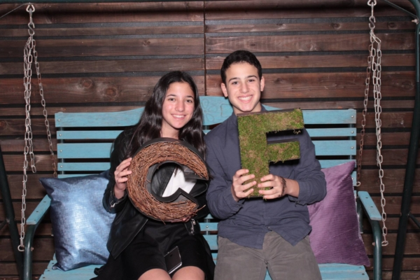 a classy photo booth photo of two teenage guests at a Los Angeles bat mitzvah