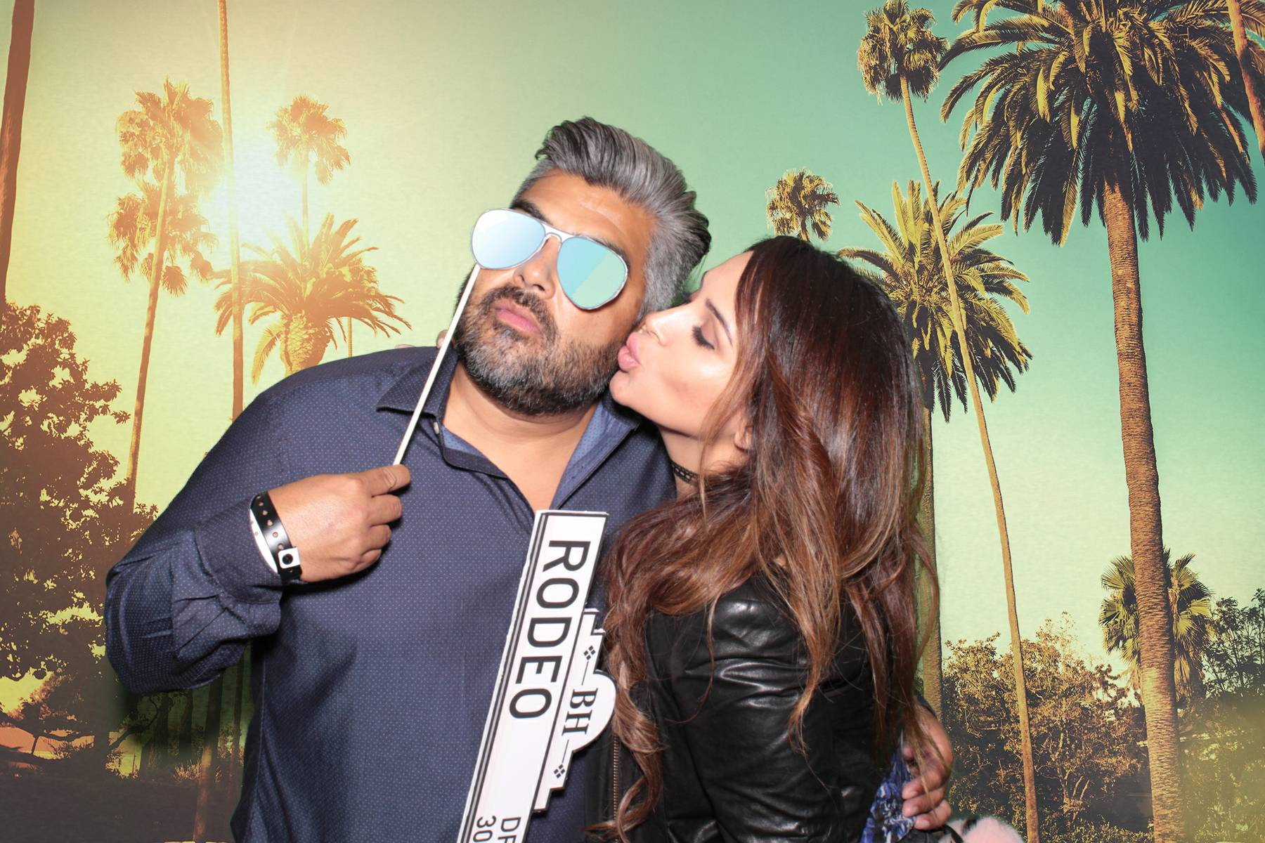 A green screen photo taken by Maple Leaf Photo Booths in Los Angeles of attendees of the 2016 Taste of LA Festival at Paramount Studios