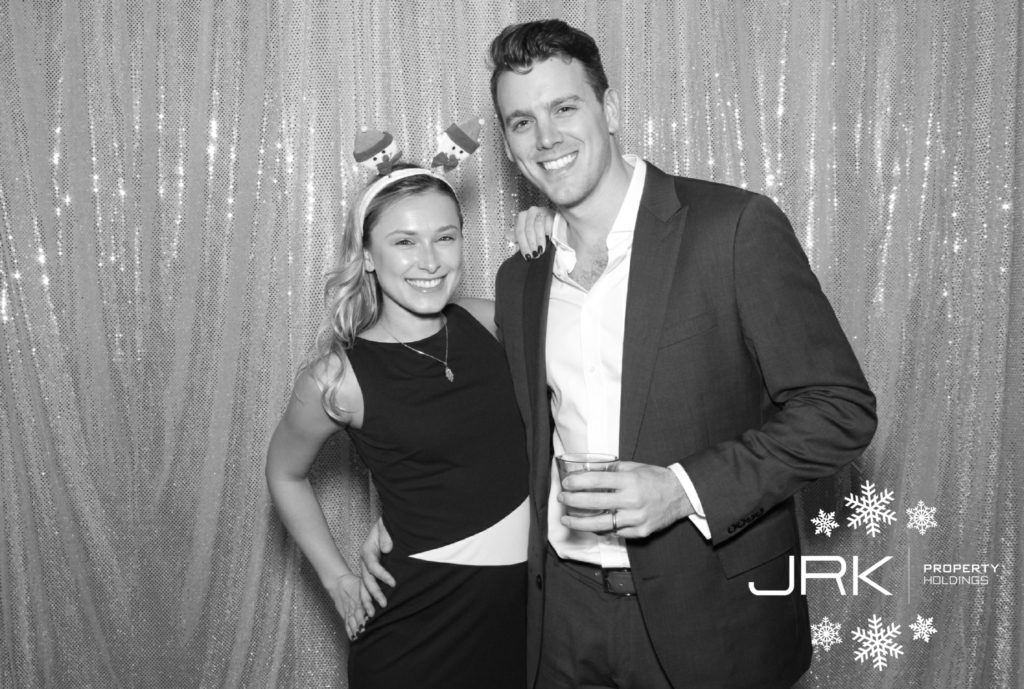 A photo booth photo of a good looking young couple at the jrk holidays holiday party