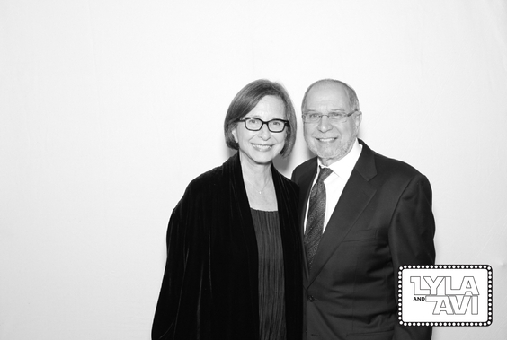 a black and white photo booth photo taken at holiday party. Photo taken by Maple Leaf Photo Booth rentals in San Francisco