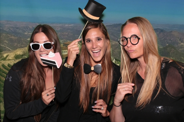 A green screen photo booth photo taken at a Malibu wedding by Maple Leaf Photo Booths