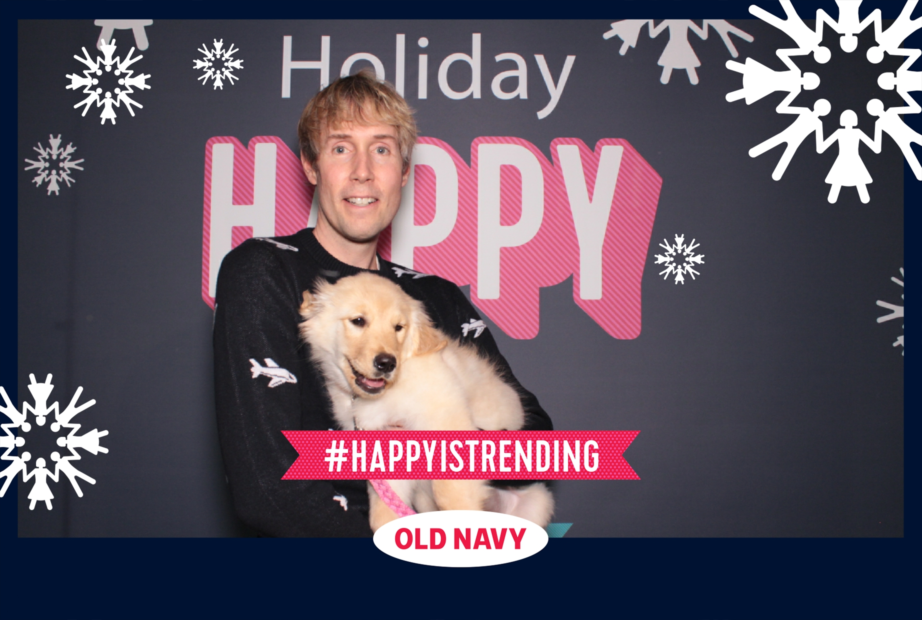 a photo booth photo at an Old Navy branding activation in Los Angeles with live puppies as props