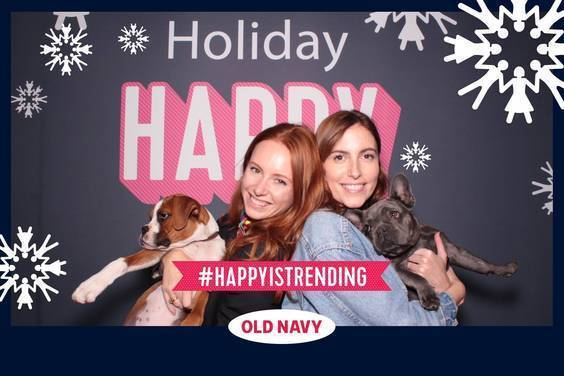 a photo booth photo with party guests and puppies at an Old Navy holiday party. Photo taken by Maple Leaf Photo Booth rentals in San Francisco