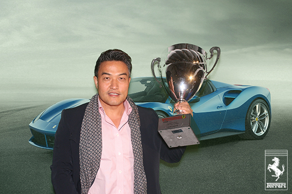 A green screen photo booth photo of a guest at Ferrari's 488 Spyder unveiling event in Beverly Hills