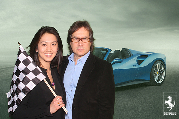 A green screen photo booth photo of guests at Ferrari's 488 Spyder unveiling event in Beverly Hills