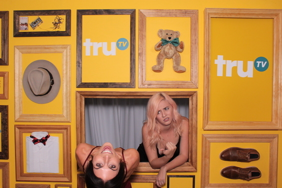 two girls having fun in a custom built photo booth set for Tru TV's Upscale with Prentice Penny premiere. Photo taken by Maple Leaf Photo Booth rentals in New York City